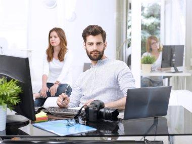 graphic designer with businesswomen