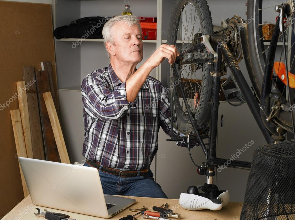 retired man working in his workshop