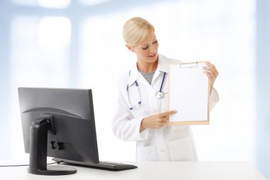 medical assistant holding clipboard
