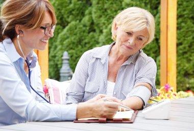 Elderly woman in garden with nurse