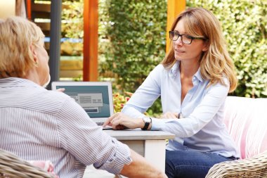 advisor consulting with retired woman