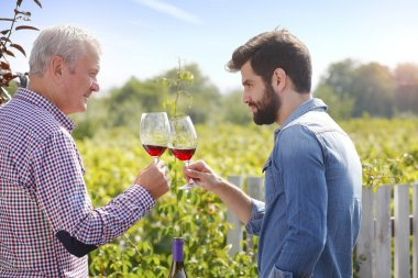 Winemaker and  man holding gasses
