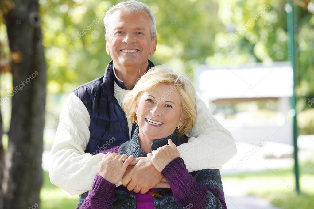 man huging beautiful elderly woman