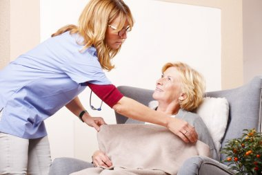nurse caring for elderly woman