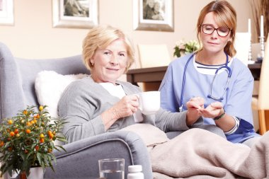 home care nurse and giving medication