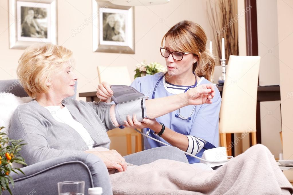 home care nurse giving medication