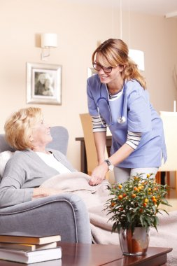 caregiver covering woman