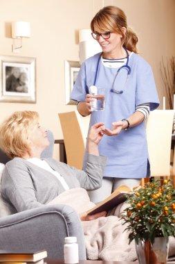 nurse holding in hand a mug