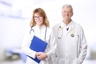 female doctor and senior doctor standing