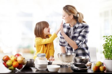 mom giving high five to  daughter.