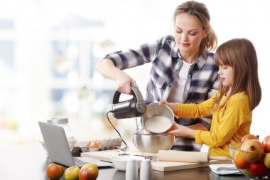 mother and daughter using kitchen robot