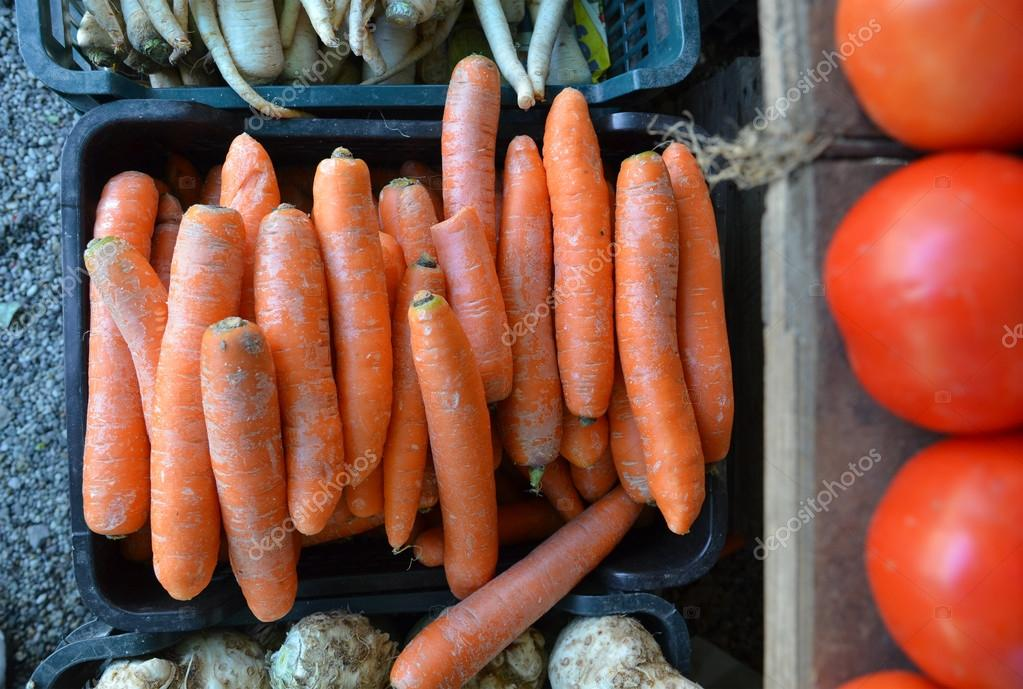 Fresh garden carrots for sale at farmers market.