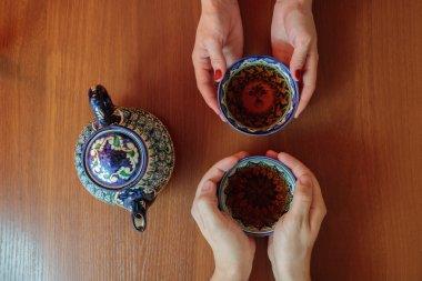 Man and woman drinking tea in Samarkand, Uzbekistan. Oriental cuisine.