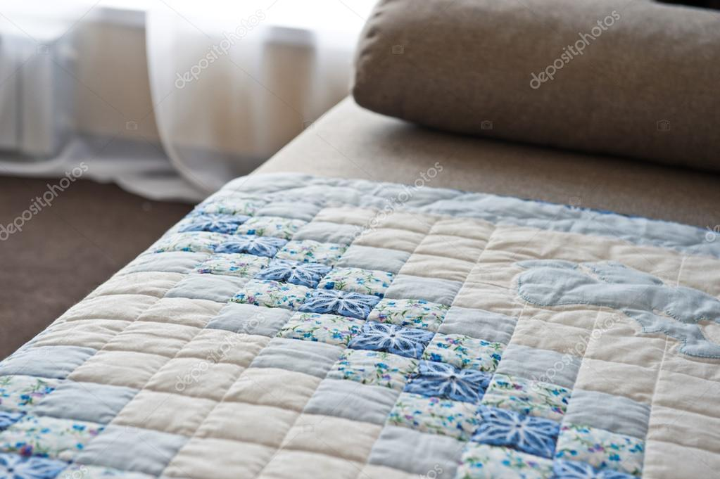Embroidered by dark blue and white patterns a scrappy blanket 29