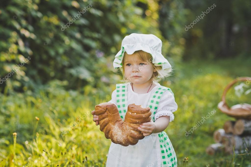 The child in the dress of a cook walking in the garden 4632. — Stock ...