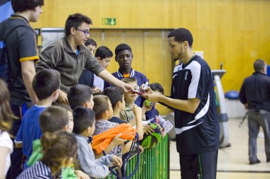 Player signing autographs
