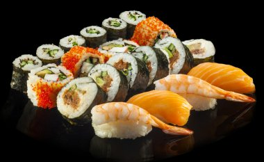 Delicious Sushi rolls with shrimp, salmon, tuna, cucumber and av