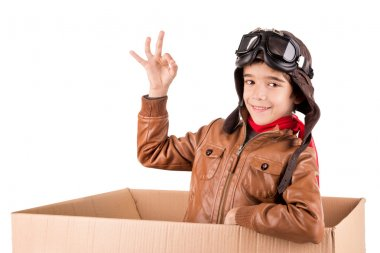 Young boy pilot flying a cardboard box isolated in white stock vector