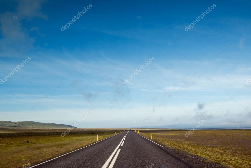 Empty road with blue sky