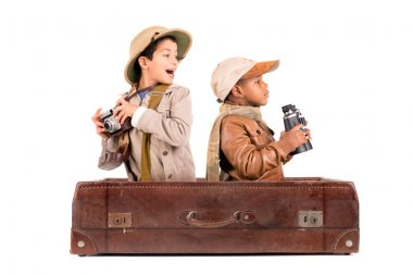 Two kids in suitcase on white