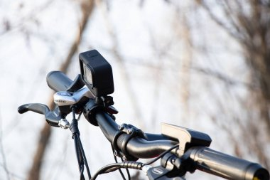 Ukraine Dnipro 30.03.2021 - Xiaomi HIMO C26 electric bike with camera pro 9 on the handlebars in the forest in spring, eco technologies