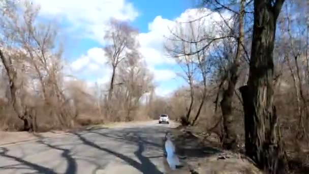 Ukraine Dnipro 06.04.2021 - city road with cars in spring, video shooting from a bicycle, cycling