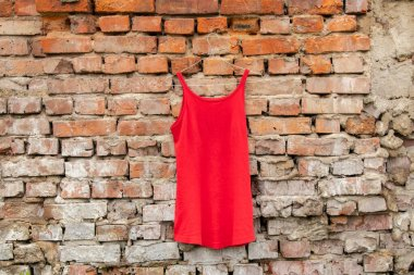red women summer dress spring hangers on the wall at home on the street, women's clothing fashion