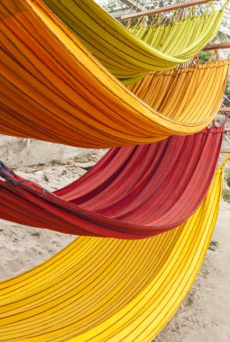 Multi-color hammocks in little village market place in Ecuador