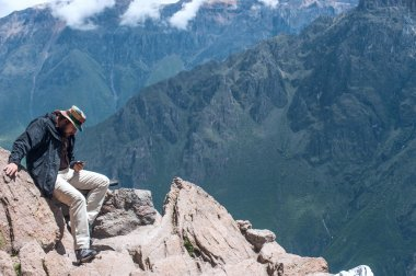 Man posts message to social networks, sitting on the edge of the