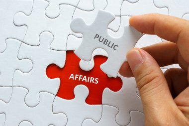 Piece of jigsaw puzzle with word PUBLIC AFFAIRS.