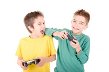Little boys playing videogames isolated in white stock vector
