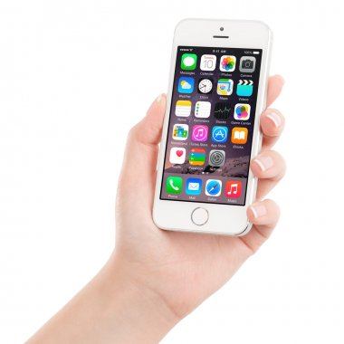 Apple Silver iPhone 5S displaying iOS 8 in female hand, designed