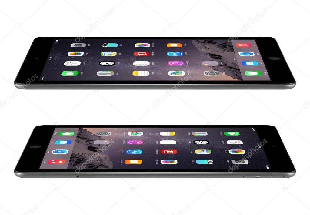 Apple Space Gray iPad Air 2 with iOS 8 lies on the surface, desi
