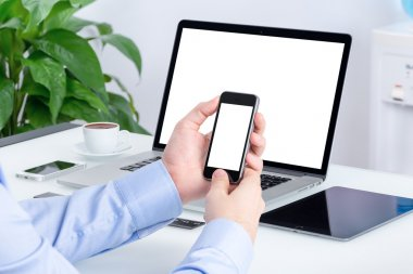 Male hands using smartphone mockup at the office desk