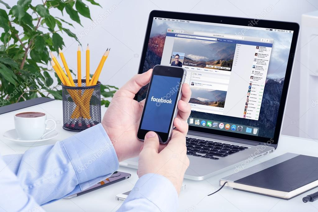 Facebook app on the Apple iPhone display and Apple Macbook Pro