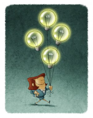 Businesswoman walking with four flying illuminated bulbs