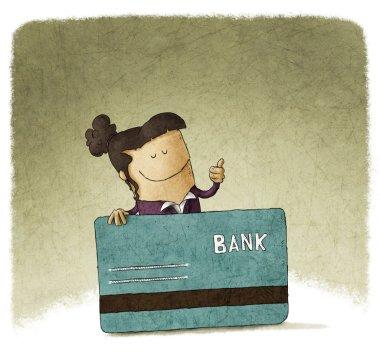 Woman showing her debit card