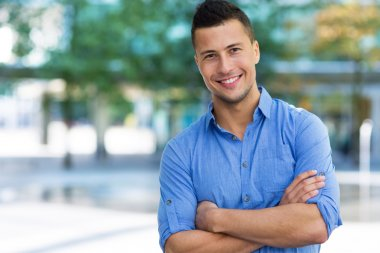 Young man posing   outdoors stock vector