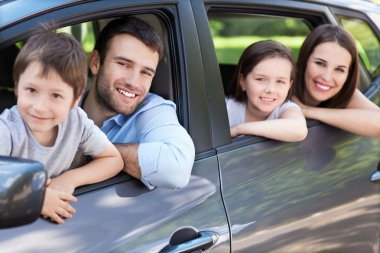 Family sitting in the car