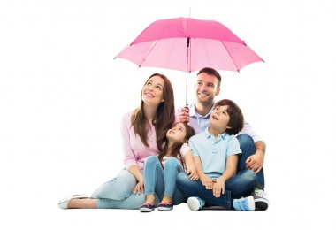 Family with pink umbrella