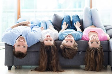 Family lying on sofa