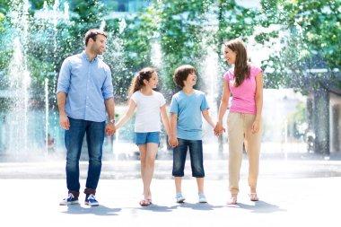 Happy family ready to jump