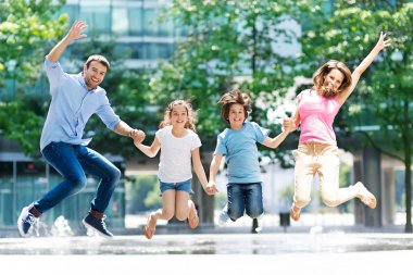 Happy young family jumping