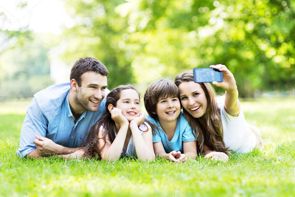 Happy young family making selfie