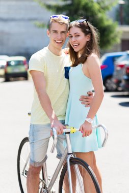 Young happy couple with bike smiling stock vector