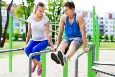 Young couple training outdoors