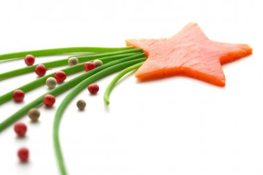 Salmon star-shaped, chives and peppercorns on white background