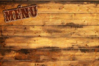 Plate menu nailed to a wooden wall