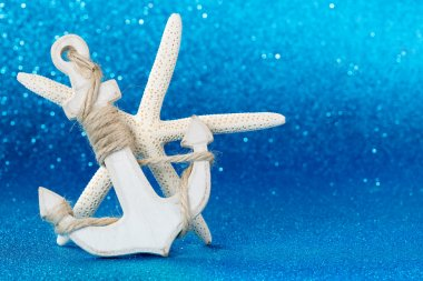 white anchor and starfish in the seabed