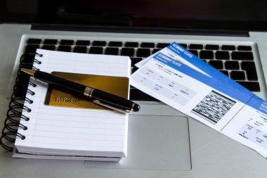 Buying Airline tickets on a laptop